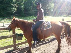Kat on a horse